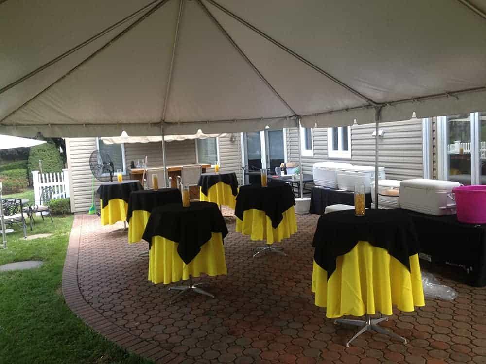 backyard tent rental and setup over patio