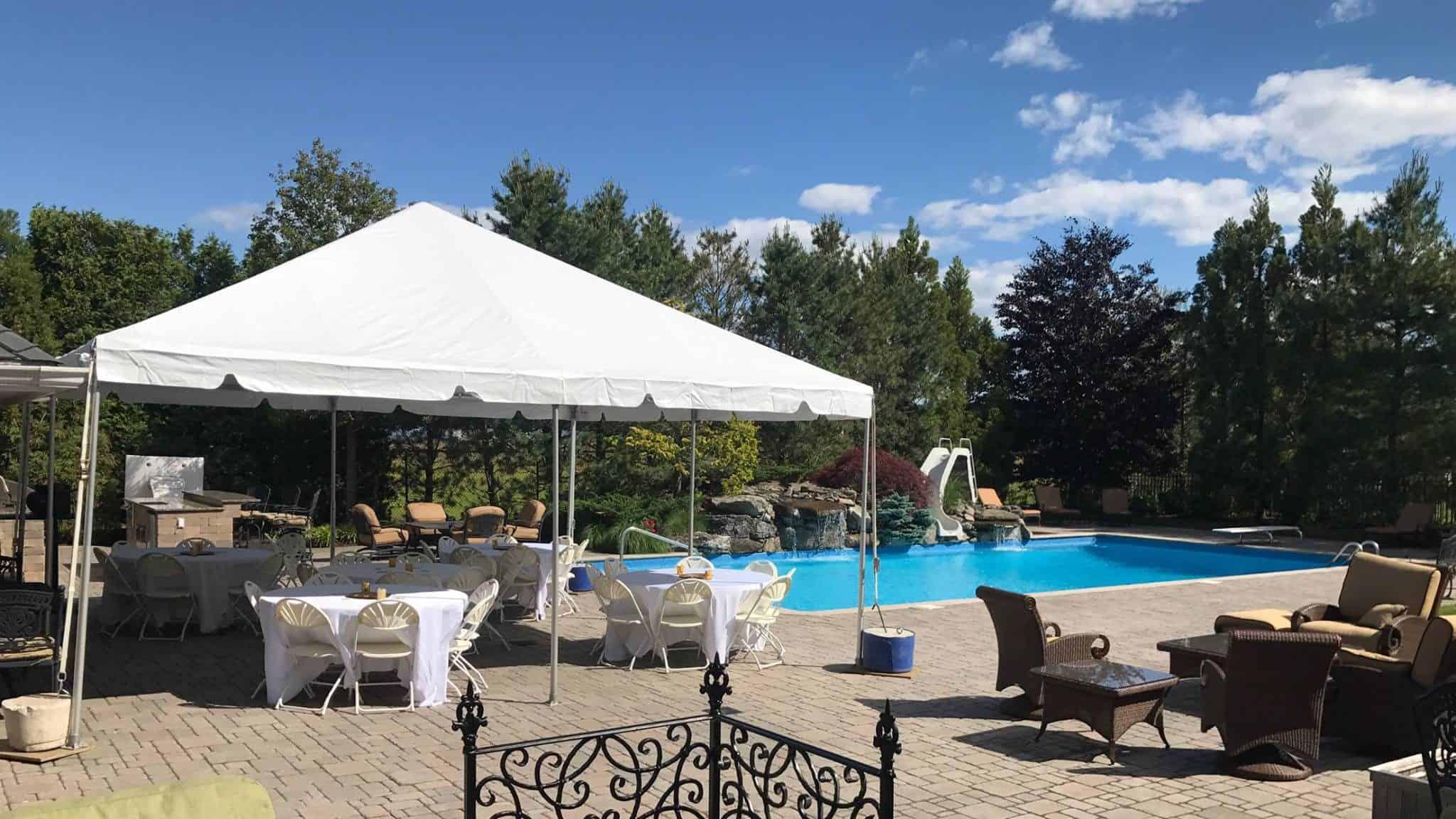 backyard tent rental setup next to pool