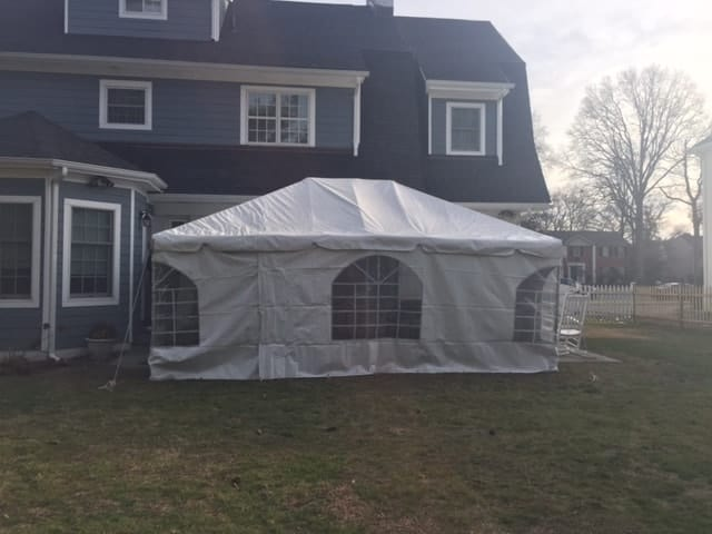 heated tent rental on grass outside of house