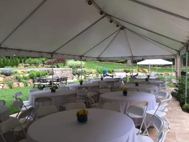 beautiful backyard tent rental setup