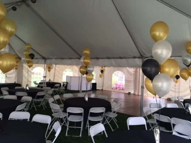 black and gold tent rental with dance floor rental