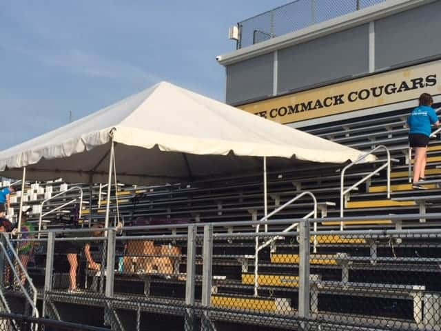 commack high school tent rental setup over bleachers