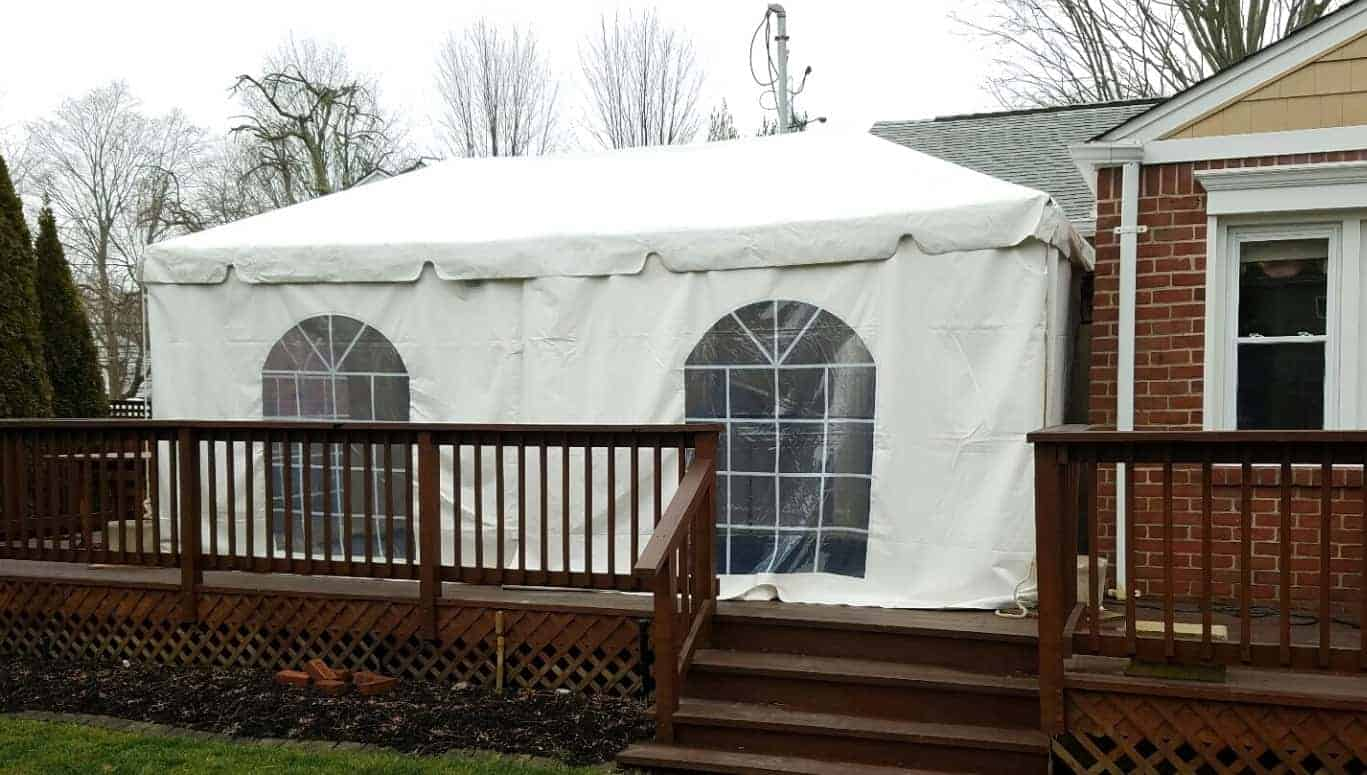 heated tent setup next to house