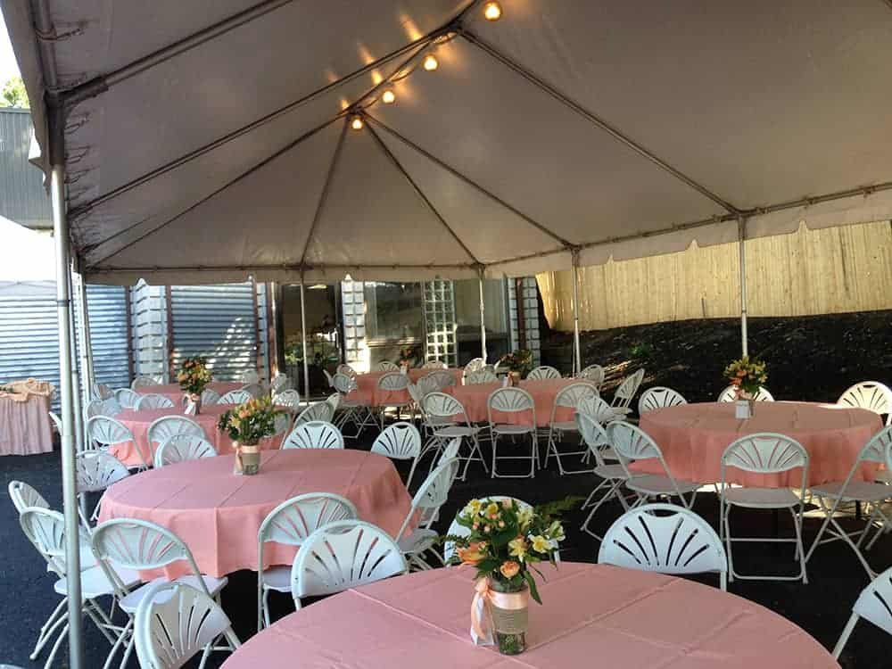 pink linens with tent rental in backyard