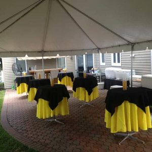 backyard tent rental and setup over patio