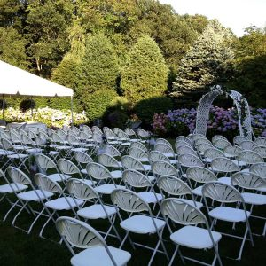 wedding tent and backyard setup with chairs